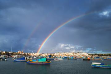 Double rainbow over the fisher village Marsaxlokk, Malta