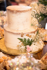 Delicious decorated cake at festive dessert party table