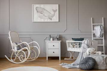 Modern grey baby nursery design in tenement house, copy space and poster on empty wall