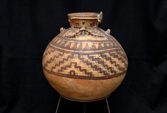 """Pre-columbian ceramic called """"Huaco"""" from unidentified ancient Peruvian culture. Pre inca handcrafted pottery piece made by ancient civilization."""