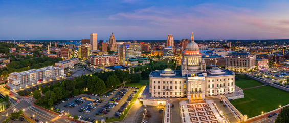 Fotomurales - Aerial panorama of Providence skyline and Rhode Island capitol building at dusk. Providence is the capital city of the U.S. state of Rhode Island. Founded in 1636 is one of the oldest cities in USA.