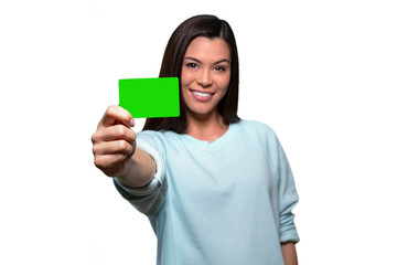 Young smiling female entrepreneur holding new business credit card, banking finance debit bank account