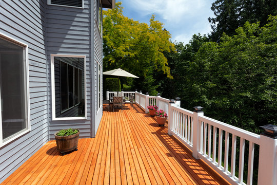 Brand new red cedar outdoor wooden patio during nice day