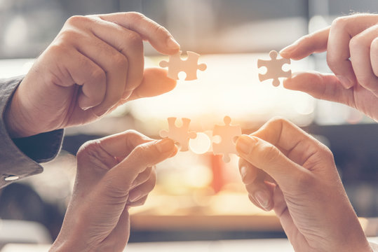 Business hands strategy concept. Implementation improving strategy team solution organization. Piece of jigsaw assembly Implement puzzle. Hands of team connect business people solutions strategy