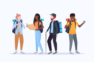 group tourists hikers with backpacks holding compass and travel map searching direction hiking concept mix race travelers on hike full length white background flat horizontal Wall mural