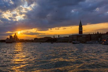 Beautiful sunset over Venice Lagoon ancient monuments
