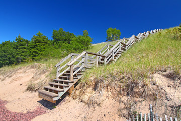 Wall Mural - Staircase leads to a secluded beach along Lake Superior on the Keweenaw Peninsula Michigan.