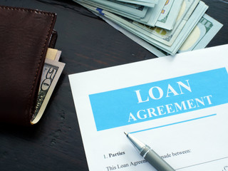 Loan agreement application and pen for filling in.