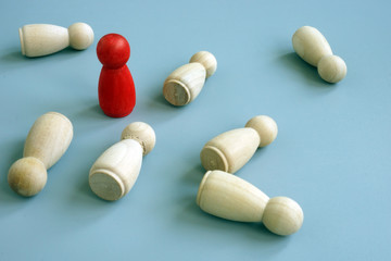 Success business advantage in competition concept. Red figurine as symbol competitive edge.