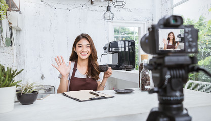 Startup successful small business owner sme beauty girl video online marketing with camera in cafe. Portrait of young asian tan woman barista cafe owner. SME entrepreneur business concept