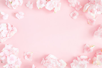 Flowers composition. Hydrangea flowers on pastel pink background. Flat lay, top view, copy space