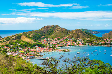 Canvas Prints Pool Terre-de-Haut, Guadeloupe. Colorful landscape with village, bay and mountains.