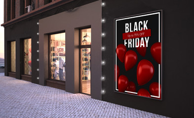 black friday poster mockup on a wall near fashion store