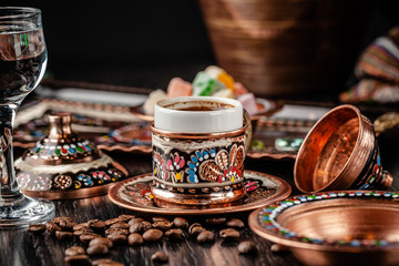 The concept of Turkish cuisine. Turkish brewed black coffee. Beautiful coffee serving in the restaurant. Background image. copy space