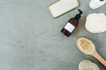 Bath products: liquid soap, brush, mirror, sponge. Spa composition. Flat lay, top view.