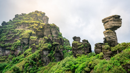 Mushroom-shaped stone and view of the old golden summit in Fanjing mountain in Guizhou China