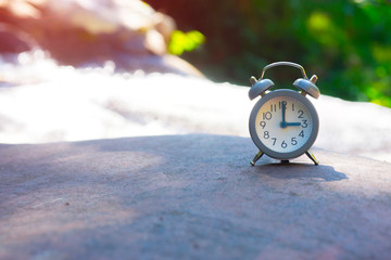 picture Alarm clock on the background, natural outdoor location