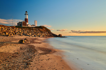 Montauk Lighthouse and beach at sunrise, Long Island, New York, USA. Wall mural