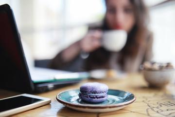 Girl eating coffee cakes