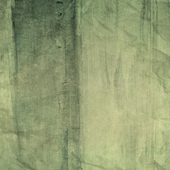 old green wrinkled paper texture or background