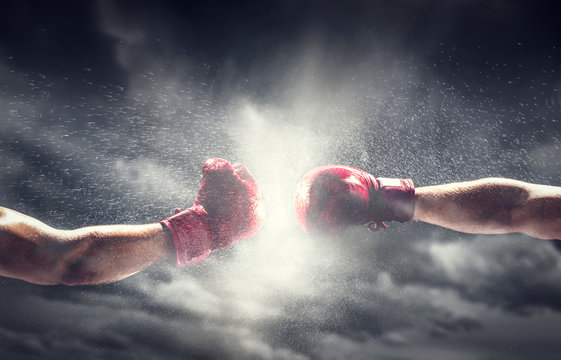 Two boxing gloves punch. Box and fight