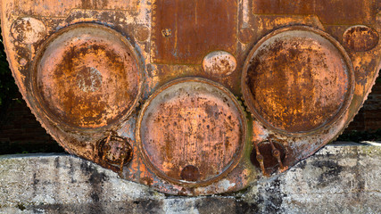 Big rusted barrel with three round lids