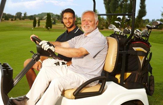 Happy golfers in golf cart