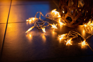 Light chain and candles create a cosy atmosphere. Romantic. Christmas.