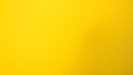 Wall Mural - wall cement yellow background or texture