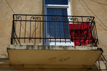 balcony with drying red towel