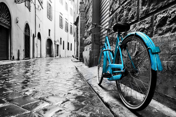Aluminium Prints Bicycle Retro blue bike on old town street.