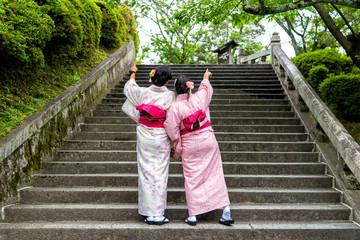 Asians woman wearing japanese kimono at garden.