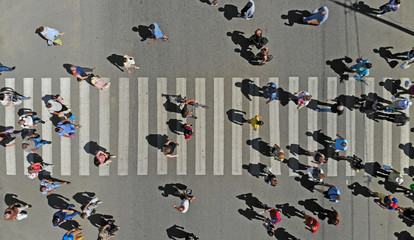 Aerial. People crowd on pedestrian crosswalk. Top view. Fototapete