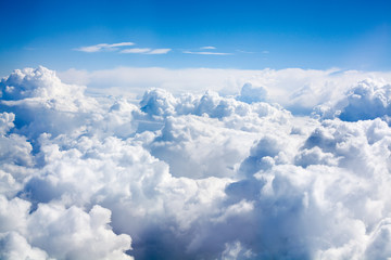 White clouds on blue sky background close up, cumulus clouds high in azure skies, beautiful aerial...