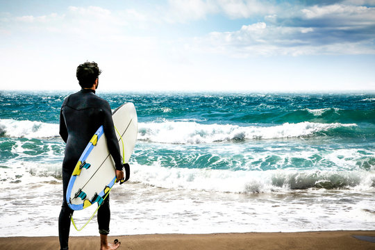 Summer time on beach and surfer with board. Summer time and free space for your decoration.