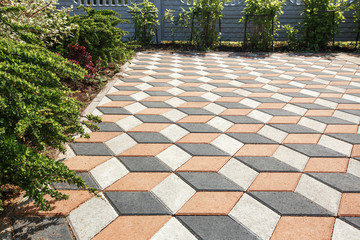 Paving the yard with colored paving tiles in the shape of a diamond. Wall mural