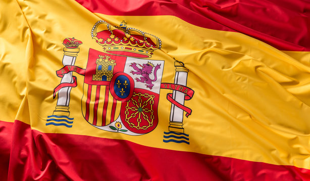 Spain flag of silk. Spanish national colours with emblem