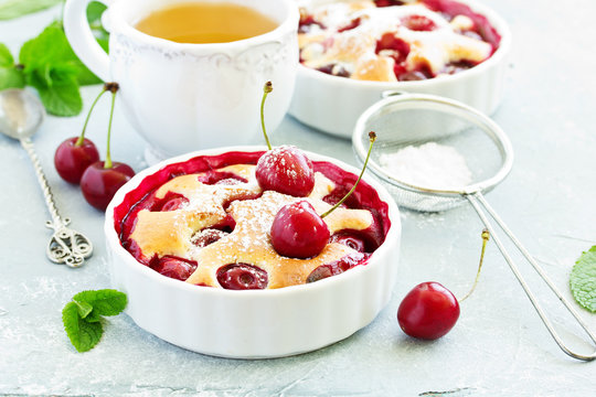 Cherry clafoutis - traditional French sweet fruit dessert.