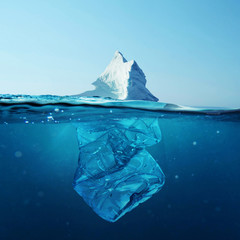 Keuken foto achterwand Antarctica Iceberg with bottle in the ocean underwater. Environmental pollution. Plastic water bottles pollute ocean.
