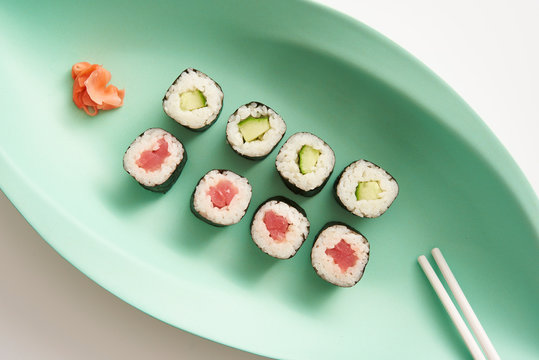 Sushi Rolls on Colorful Platters