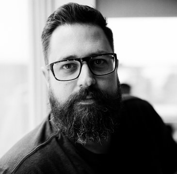 Black and white close up portrait of a man with a big beard