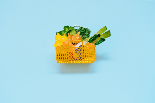 hand holding a handmade paper grocery basket