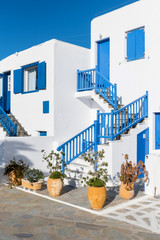 White houses with blue stairs