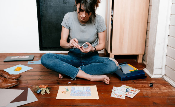 woman enjoying her free time at home doing paper handcrafts