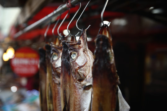 Dried fish hanging in an outdoor market