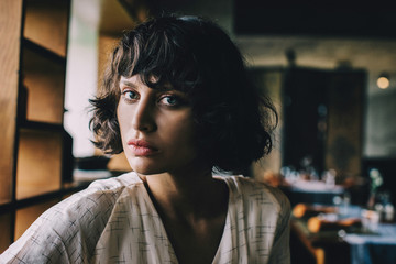 Cinematic Beauty Portrait of Young Pretty Brunette Looking at Ca