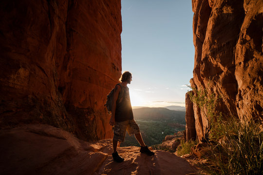 A young man watching the sunset Cathedral Rock, Sedona.
