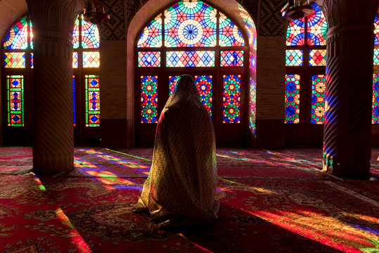 Anonymous woman inside of colorful oriental mosque