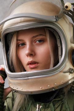 Beautiful girl wearing old space helmet