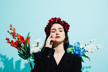 Stylish woman standing in flowers